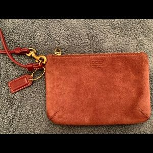 Coach Suede wristlet in a pretty rose color